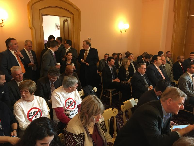 """The packed committee hearing room included representatives from the industry and activists, including some wearing t-shirts with """"591%"""" – the interest rate that they say payday lenders can now charge in Ohio."""