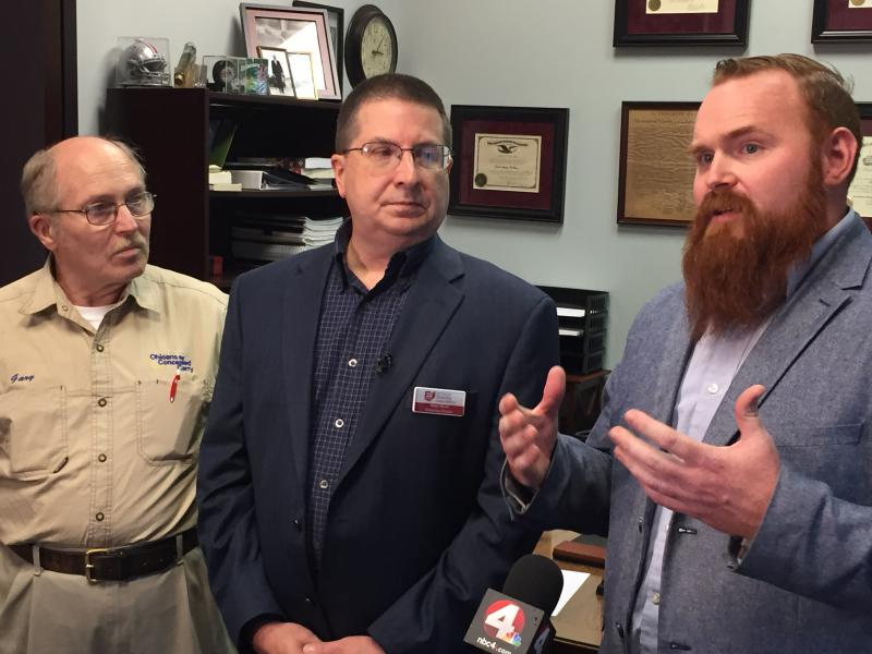 Derek DeBrosse (right) discusses the lawsuit Ohioans for Concealed Carry and the Buckeye Firearms Association filed in two county courts against the city of Cincinnati and the city of Columbus.
