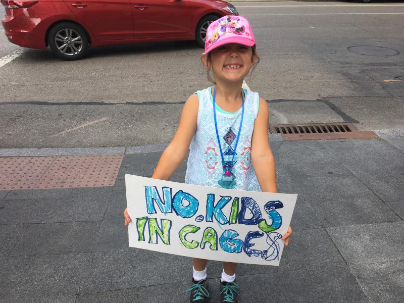 Little girl from Columbus with sign she made
