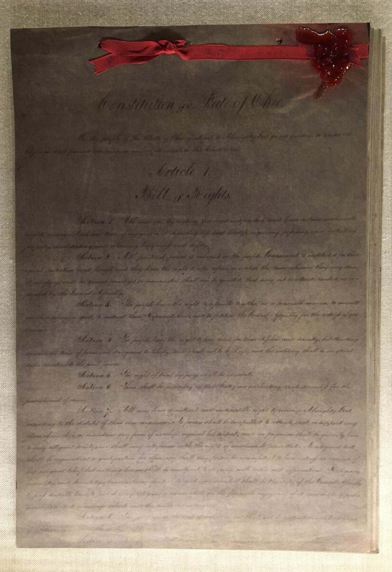 The Ohio Constitution, on display in the Statehouse Museum, was written in cursive.