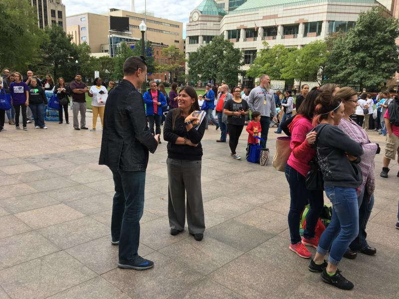 Tracy Plouck talks to an attendee at the annual Rally For Recovery at the Statehouse in September 2017.