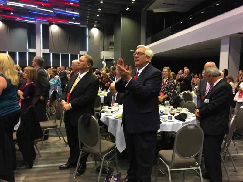Columbiana County Republican Party chair Dave Johnson applauds President Trump's speech at the Ohio Republican Party's annual state dinner.