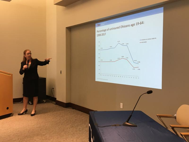 Ohio Medicaid Director Barbara Sears shows a chart demonstrating that Ohio's uninsured population dropped after Medicaid expansion was enacted.
