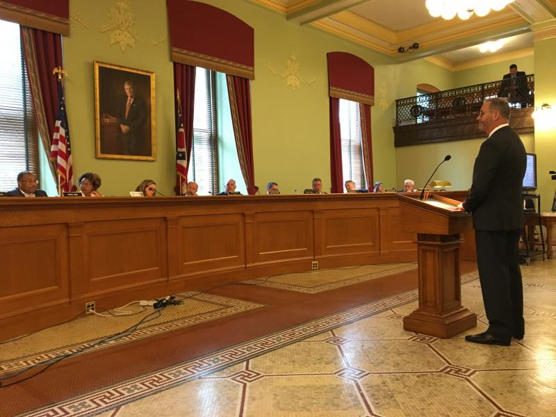 Auditor Dave Yost (R) presents his report on pharmacy benefits managers working with the state's five Medicaid managed care plans to the Joint Medicaid Oversight Committee.