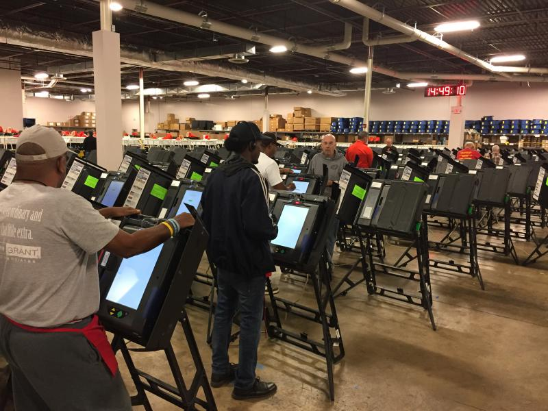 Workers at the Franklin County Board of Elections inspect each individual voting machine before storing them in a locked container, until they're shipped to local precincts.