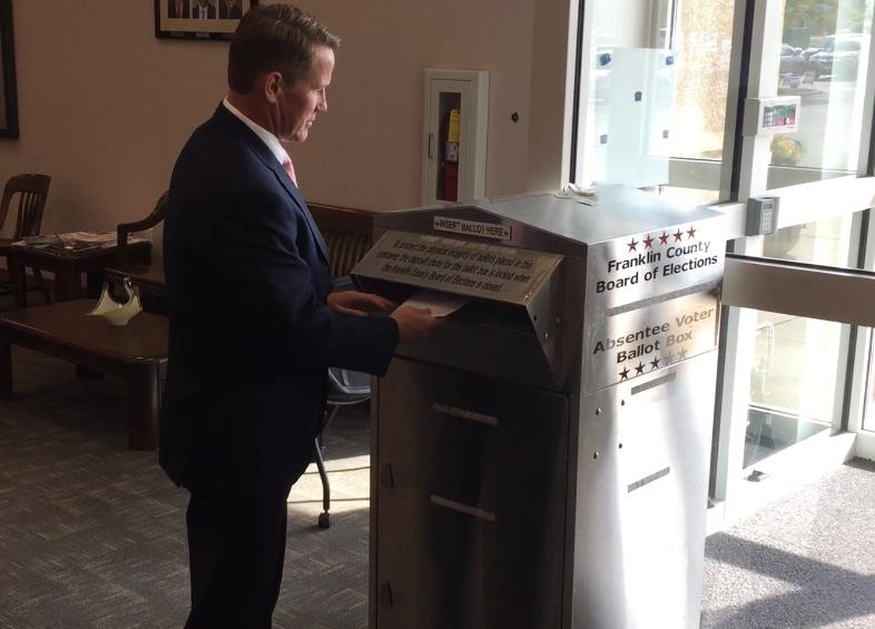Secretary of State Jon Husted drops off absentee ballot at the Franklin County Board of Elections.