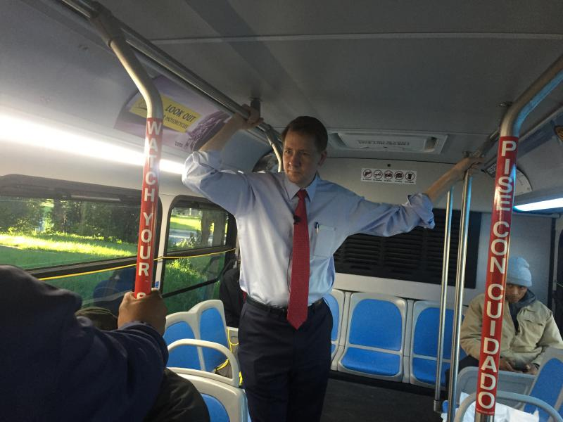 Richard Cordray, Democratic Gubernatorial Nominee, stands on the CMAX COTA bus in Columbus riding the route on Cleveland Avenue.