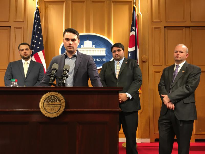 Commentator and former Brietbart editor Ben Shapiro (center) talks to reporters flanked by Aaron Baer from the Center for Community Solutions (left) and Rep. Niraj Antani (R-Miamisburg) and Rep. Andrew Brenner (R-Powell), the sponsors of the bill.