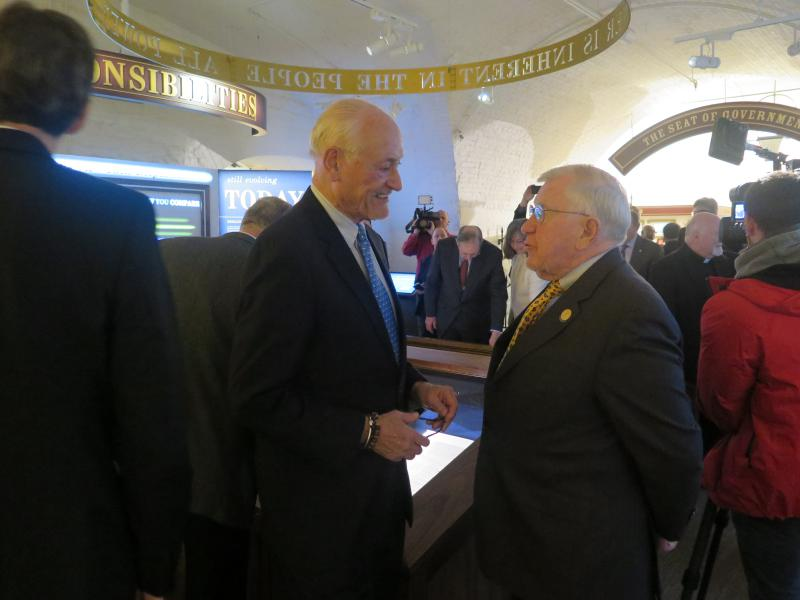 Former Gov. Dick Celeste (D) and former Senate President Richard Finan (R-Cincinnati) talk after the opening of the exhibit.