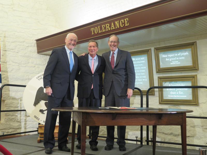 Former Gov. Dick Celeste (D), current Gov. John Kasich (R) and former Gov. Bob Taft smile at the opening of the constitutions exhibit.