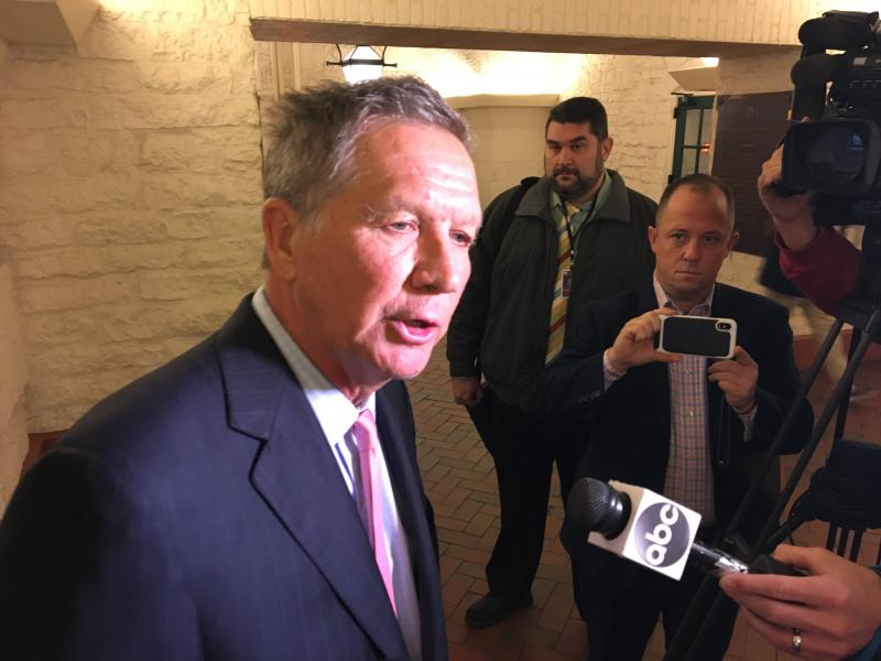 Gov. John Kasich talks to reporters after the opening of an exhibit featuring Ohio's two constitutions.
