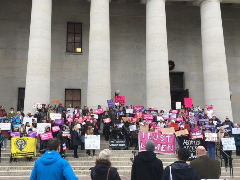 """Opponents of the """"Heartbeat Bill"""" rally outside of the Ohio Statehouse."""