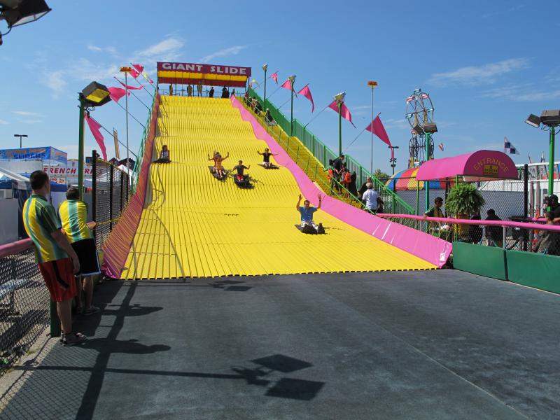 Gov. John Kasich and his family ride the Giant Slide at the Ohio State Fair in July 2012.