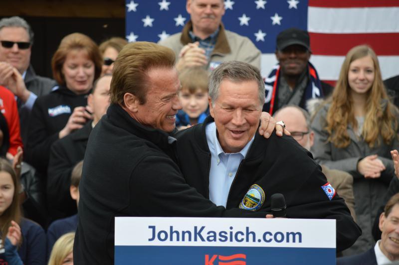 Actor and former California Gov. Arnold Schwarzenegger embraces Gov. John Kasich after endorsing his presidential campaign in 2016.