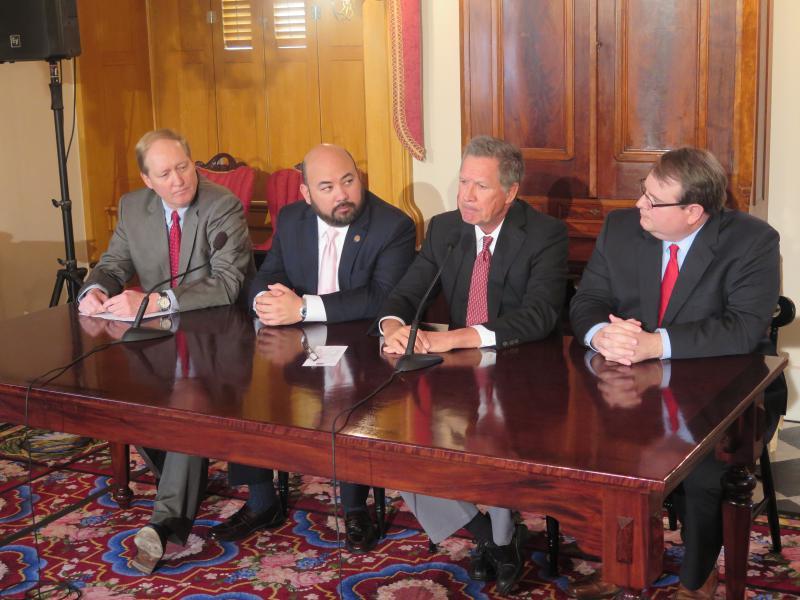 Budget director Tim Keen, then-House Speaker Cliff Rosenberger, Gov. John Kasich and Senate President Larry Obhof discuss the state's budget shortfall in April 2017.
