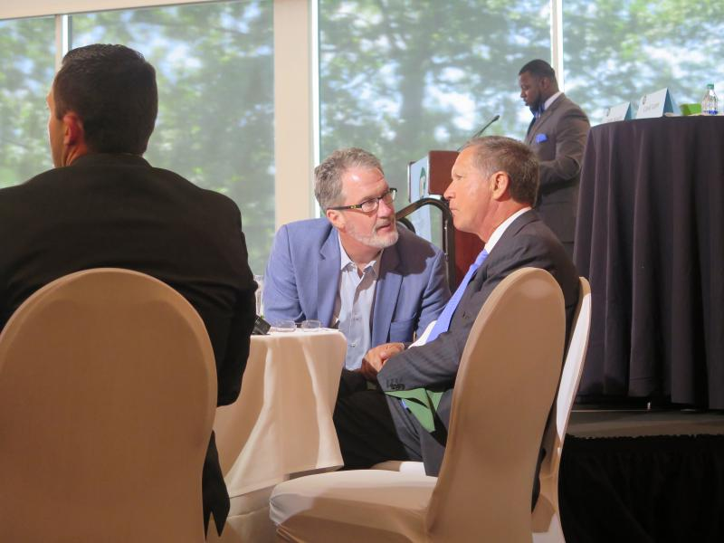 Gov. John Kasich and his first JobsOhio chief, venture capitalist Mark Kvamme, chat before Kasich's speech to the Columbus Metropolitan Club in May 2018.