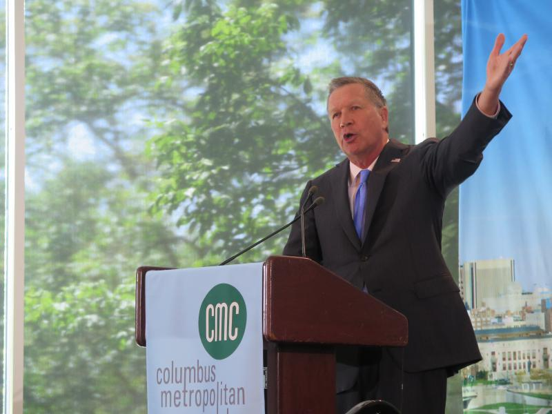 Gov. John Kasich gestures during a speech to the Columbus Metropolitan Club in May 2018.