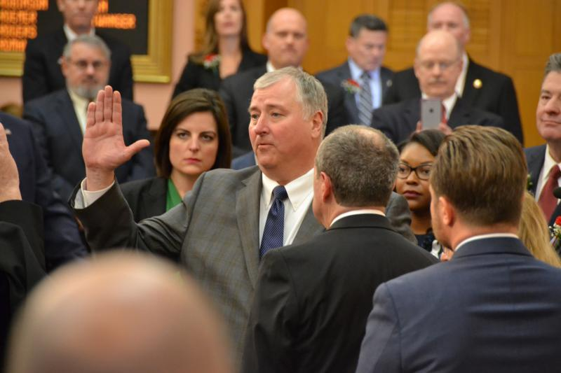 Speaker Larry Householder (R-Glenford) takes the oath of office on the floor of the Ohio House. Holding the Bible with his back to the camera is Rep. David Leland (D-Columbus).