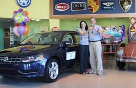Congratulations to Tom and Margaret Kuhn, winners of WCQS Ticket to Ride Summer Raffle grand prize - a 2013 VW Passat TDI SE from Harmony Motors!