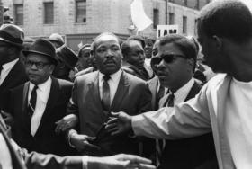 Martin Luther King Jr. is jostled in Memphis as the march he's leading on March 28, 1968 turns violent.