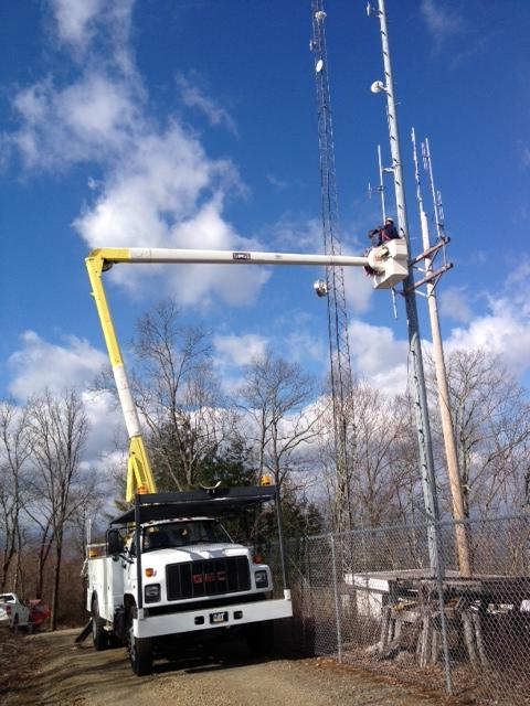 The antennae is hoisted for WMQS in Murphy.