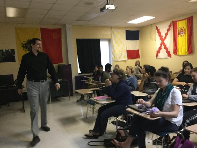 Teacher Kyle Pope discusses the last presidential debate with his Civics and Economics Honors class.