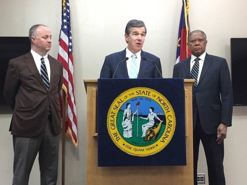 Governor Roy Cooper with Rep. Darren Jackson (left) and Sen. Dan Blue