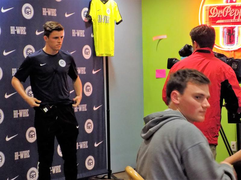 Asheville City Soccer Club team members  meet the press.
