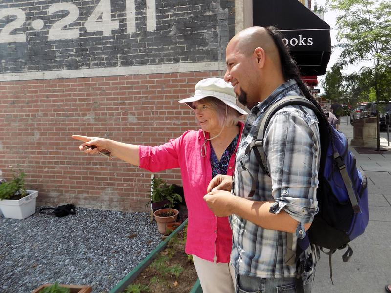 Clare Hanrahan discusses plans for raised beds with volunteer Pankho Bermejo.