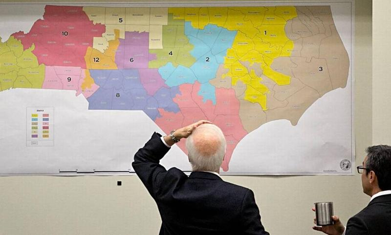 Joint Select Committee on Congressional Redistricting members review historical voting maps lining the walls during their morning meeting at the N.C. Legislature on Tuesday, February 16, 2016.