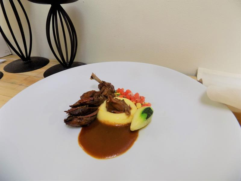 The squab stuffed with mushroom duxelle entrée is plated!