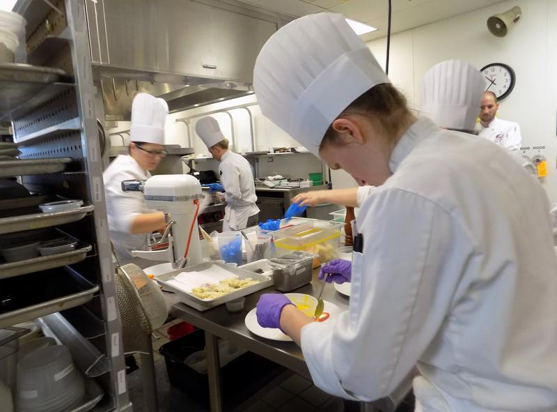 Nina Patterson prepares the salad.