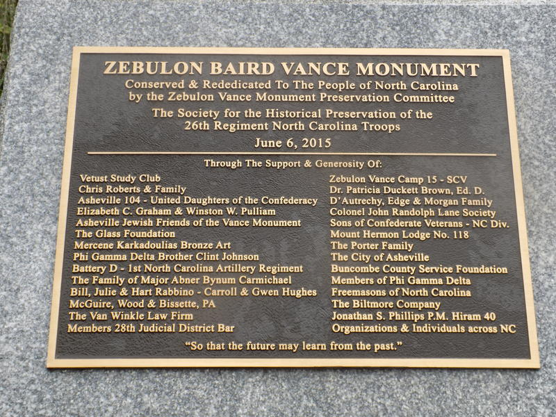 Plaque commemorating the 2015 re-dedication of the monument