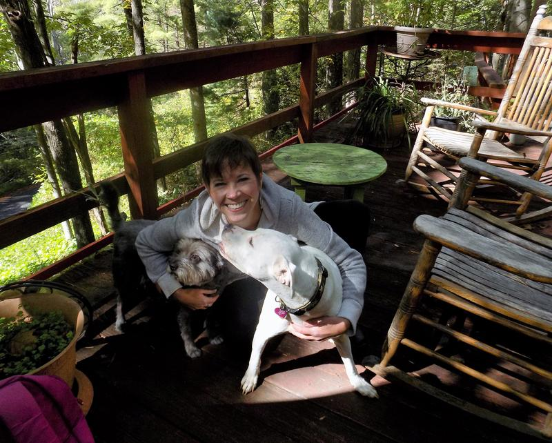 Asheville resident Kelly Johnson relaxes with her dogs at home.   As ACA enrollment day nears, Johnson is keeping a close eye on the ongoing healthcare debates in Washington and here in Western North Carolina.