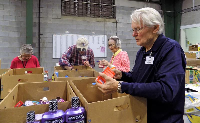 Walt Justice heads up a crew of volunteers from Givens Estates Retirement Community at  the MANNA Foodbank warehouse. MANNA Foodbank is partnering with a number of Buncombe County organizations to sponsor a hurricane relief effort.