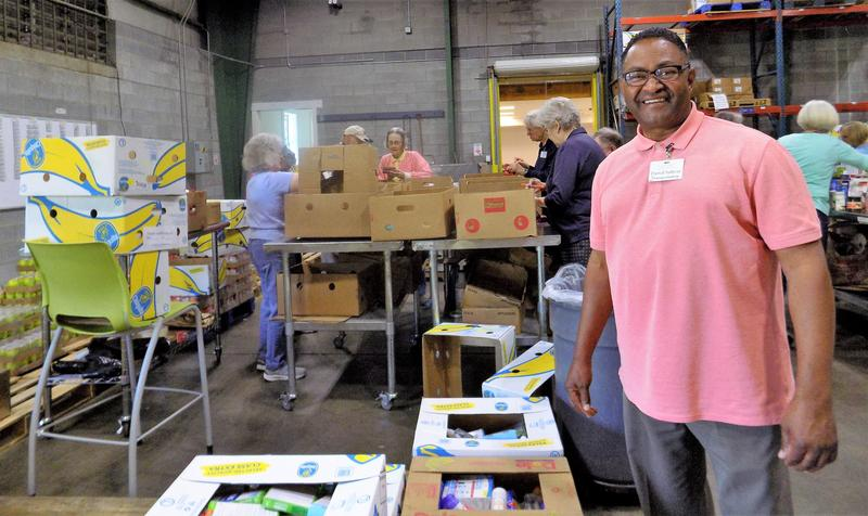 Darrel Sullivan and fellow volunteers from Givens Estates Retirement Community work in the MANNA Foodbank warehouse. MANNA Foodbank is partnering with a number of Buncombe County organizations to sponsor a hurricane relief effort.