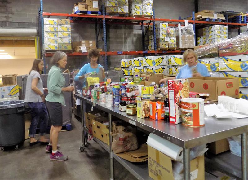 Volunteers from Givens Estates Retirement Community work in the MANNA Foodbank warehouse. MANNA Foodbank is partnering with a number of Buncombe County organizations to sponsor a hurricane relief effort..
