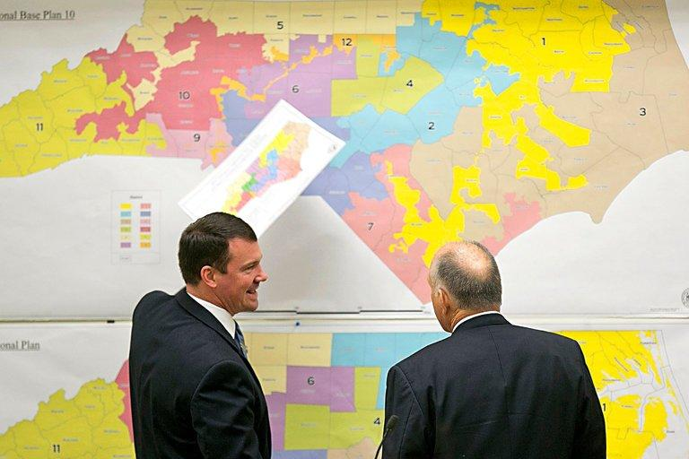 Republican State Senators Dan Soucek, left, and Brent Jackson review historic maps during a special legislative session in 2016 to set North Carolina's 13 congressional districts.
