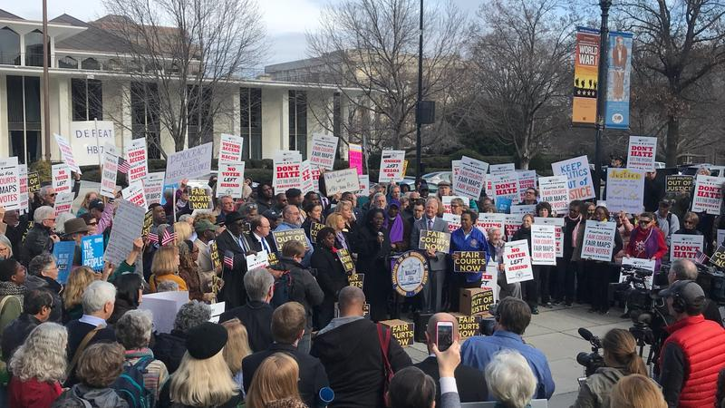 Demonstrators protest against legislative changes to the courts