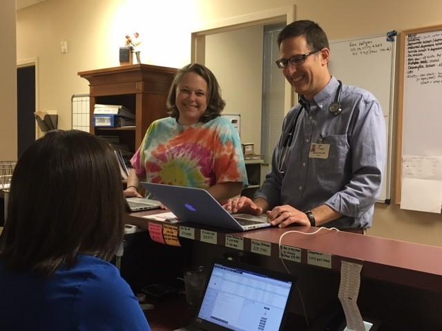 Dr. Sam Kohn talks with staff at Asheville Children's Medical Center.