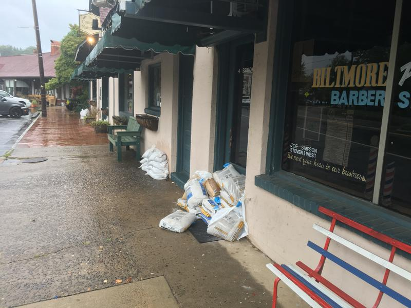 More businesses in Biltmore Village with sandbags out front
