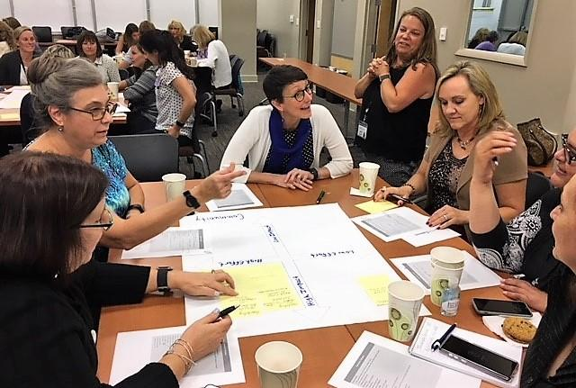 Ellis Vaughan DNP, RN,  Clinical Services Coordinator, Director of Nursing Buncombe County Health and Human Service listens as Dr. Susan Mims, Chief of Pediatrics at Mission Children's Hospital brainstorms with members of the Immunization Coalition.