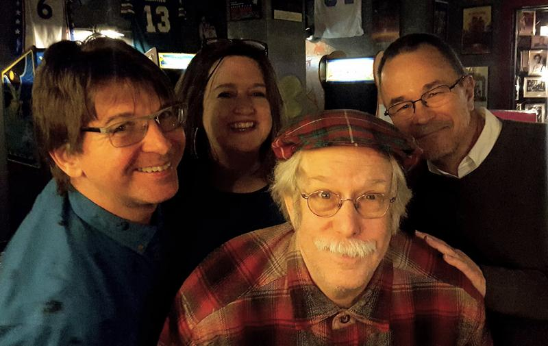 Former BPR Music Director, Dick Kowal (right), joined BPR staff members Steve Busey and Michelle Keenan  (left and second from left) in celebrating Chip Kaufmann (center).