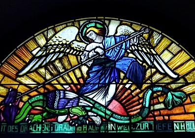 St. Michael and the dragon in stained glass from St. Rochus Church, Duisdorf, Germany,