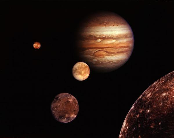 Montage of Jupiter and the Galilean satellites, Io, Europa, Ganymede, and Callisto, all photographed by Voyager 1.