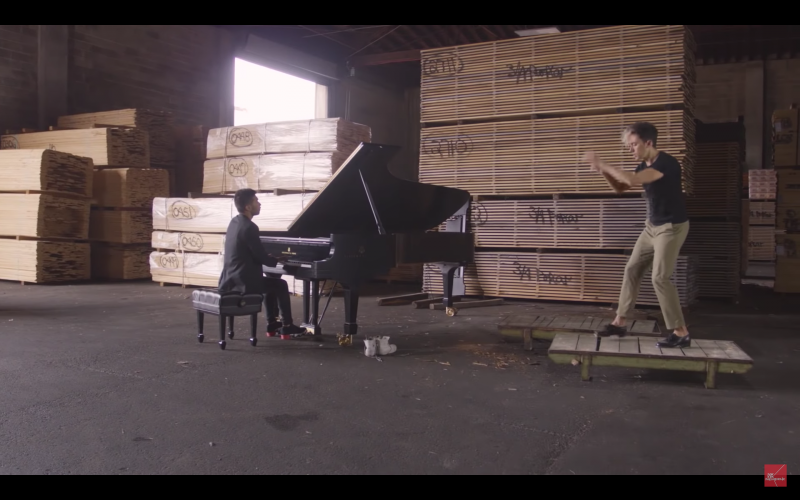 Conrad Tao plays piano while Caleb Teicher tap dances