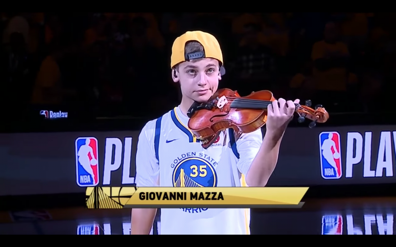 Giovanni Mazza performs at halftime during a Golden State Warriors game