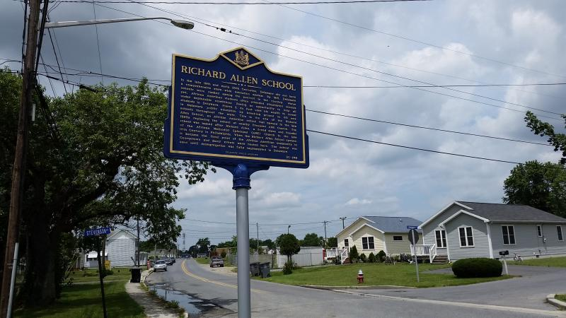The new marker kicks off a preservation effort that hopes to see the school building turned into a multicultural community center.