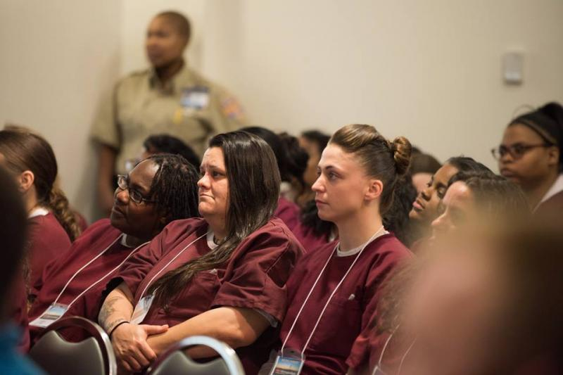Baylor inmates listen from the audience during the TEDx event.