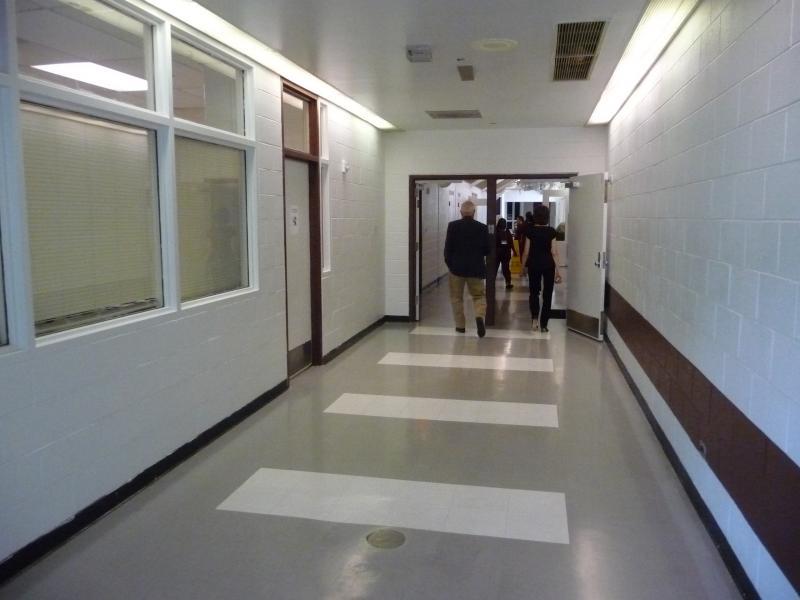 Guests walk the halls of Baylor prison.